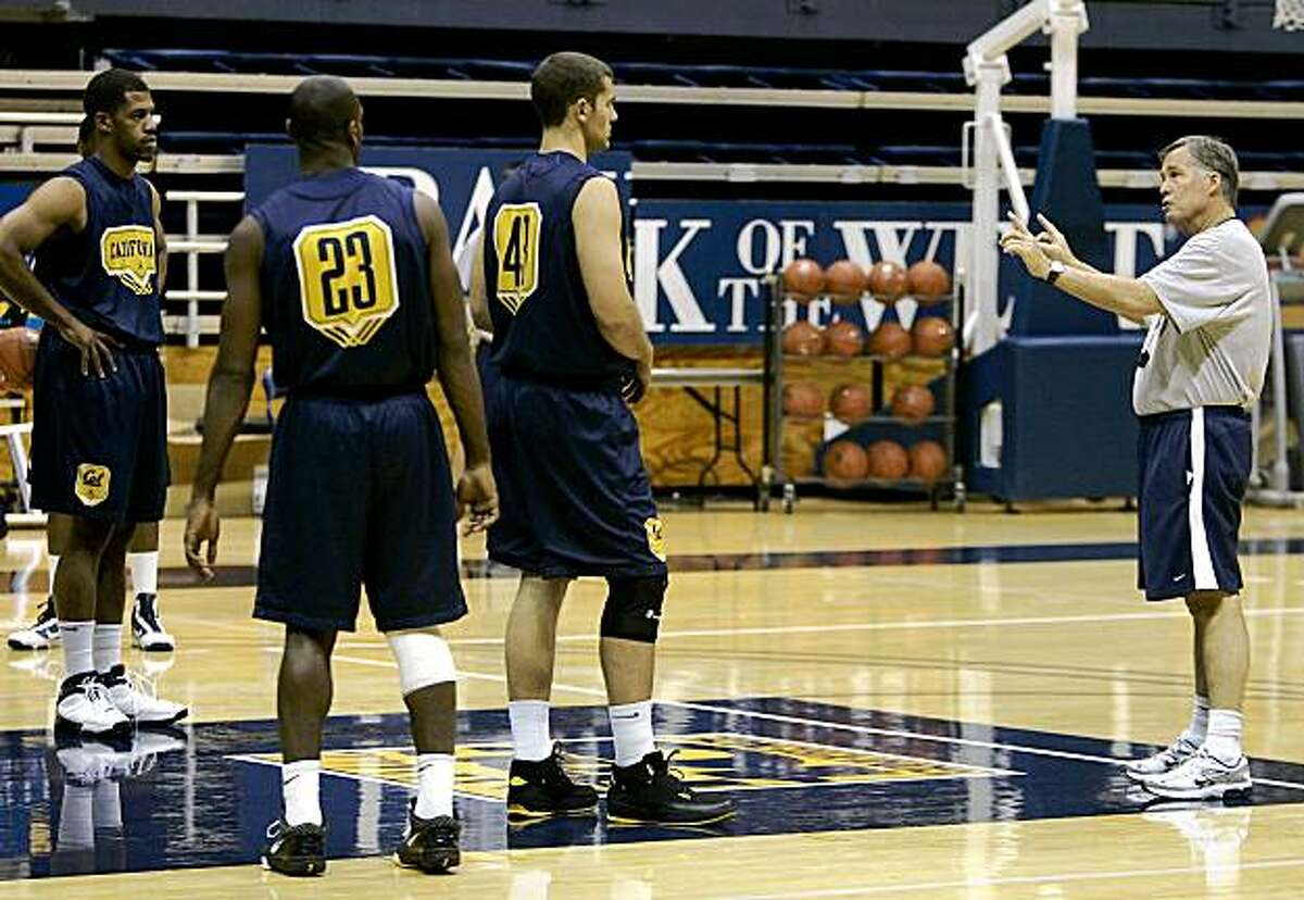 California coach Mike Montgomery, right, works with Jamal Boykin, left, Patrick Christopher (23) and Harper Kamp during men's NCAA college basketball practice on the Berkeley, Calif., campus, Wednesday, Oct. 21, 2009. (AP Photo/Tony Avelar)