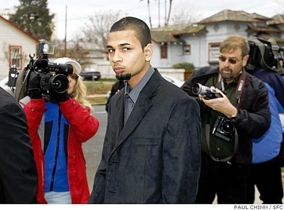 One of the two Dahliwal brothers injured in the tiger attack walks past news photographers after the funeral services for 17-year-old Carlos Sousa, Jr. in San Jose, Calif. on Tuesday, Jan. 8, 2008. Sousa was killed in the Christmas Day tiger attack at the San Francisco Zoo.PAUL CHINN/The Chronicle Photo: PAUL CHINN, SFC