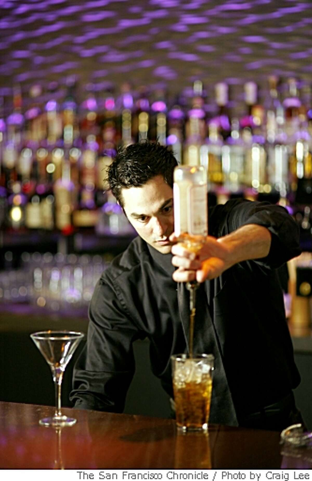 Wes Bouchia, bar manager at Yoshi's in San Francisco, Calif., on May 24, 2008. He is making a cocktail called the Rusty Gate.Photo by Craig Lee / The San Francisco Chronicle