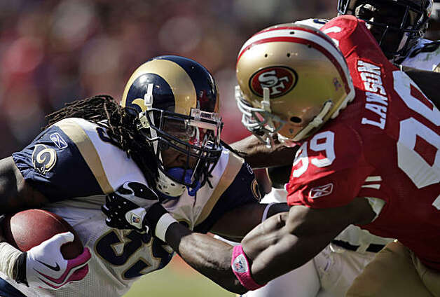 The 49ers' Manny Lawson stops a run by the Rams' Steven Jackson in the third quarter at Candlestick Park in San Francisco on Sunday. Photo: Carlos Avila Gonzalez, The Chronicle