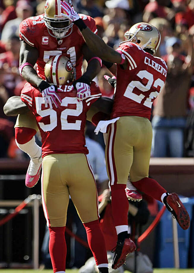 49ers Takeo Spikes, top, and Nate Clements, right, celebrate with Patrick Willis after Willis intercepted a Kyle Boller pass and ran it back for a touchdown in the third quarter of their game against the St. Louis Rams at Candlestick Park in San Francisco on Sunday. Photo: Carlos Avila Gonzalez, The Chronicle