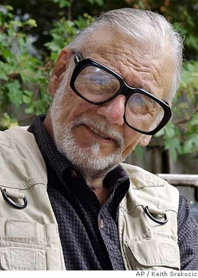 "George Romero, the filmmaker most known for his ""Night of the Living Dead,"" and its' subsequent sequels, talks about a new project tentatively called ""Land of the Dead"" while sitting in the backyard of his home in Pittsburgh's Shadyside neighborhood in this file photo from July 23, 2004. Romero has died at the age of 77. Photo: KEITH SRAKOCIC"