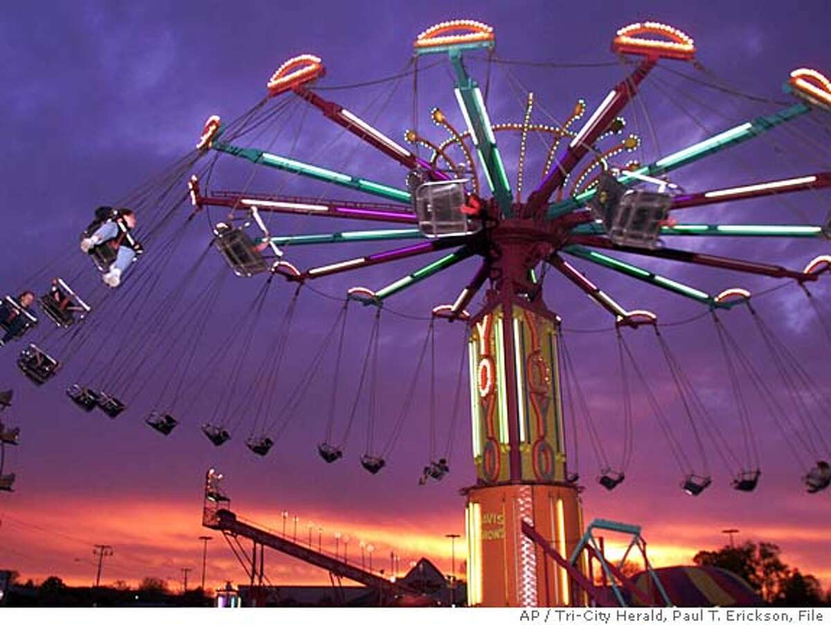 *** FILE *** This 1999 file photo shows the carnival ride, called the Yo-Yo, similar to the one which collapsed shortly after 6 p.m. Friday May 16, 2008 injuring all 24 people aboard at the Calaveras County Fair and Jumping Frog Jubilee, about 80 miles southeast of Sacramento. (AP Photo/Tri-City Herald,Paul T.Erickson, FILE)