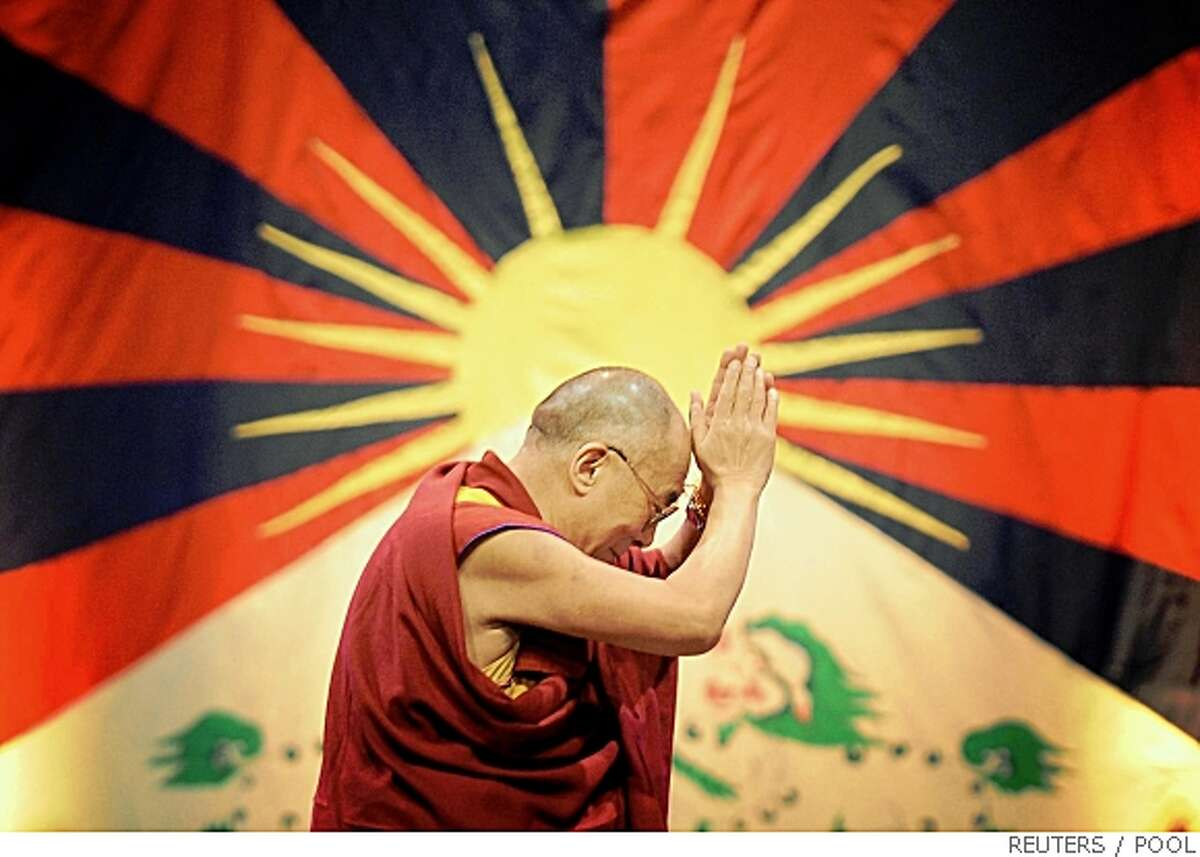 The Dalai Lama prepares to address an audience at the Royal Albert Hall, in central London on May 22, 2008. REUTERS/Stefan Rousseau/Pool (BRITAIN)