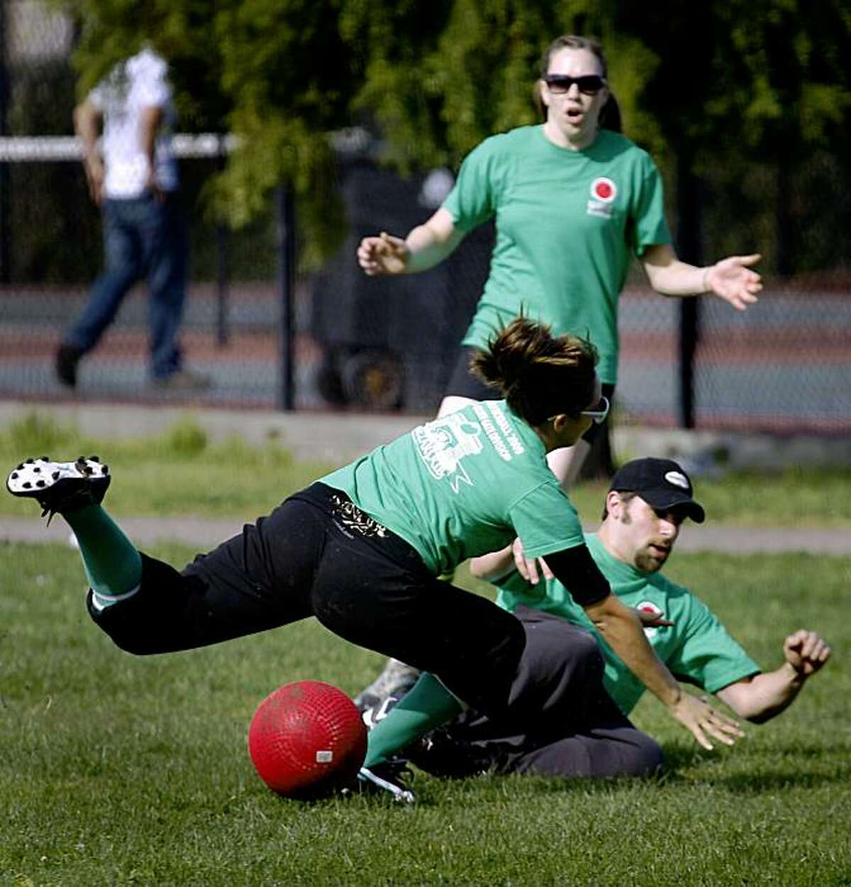Players on the Spaceballs kickball team collide while fielding a kick by the High Rollers team during a game in a 16-team tournament of the World Adult Kickball Association Golden Gate division in San Francisco, Calif., on Saturday, Oct. 24, 2009.