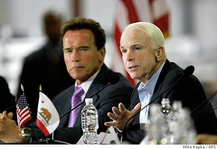 With California Gov. Arnold Schwarzenegger by his side, Republican nominee, Senator John McCain speaks to a group of supporters in a Silicon Valley lighting manufacturing plant called Finelight Inc. on Wednesday May 22, 2008 in Union City, Calif.  Photo by Mike Kepka / San Francisco Chronicle Photo: Mike Kepka, SFC