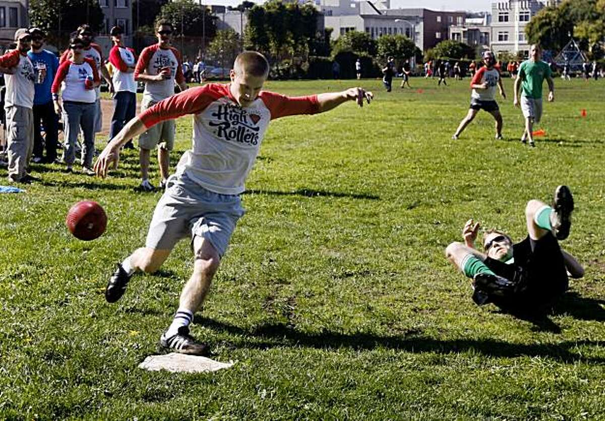 Matt Thomas (left) of the High Rollers scores a run in the late innings of a kickball game against the Spaceballs in a 16-team tournament of the World Adult Kickball Association Golden Gate division in San Francisco, Calif., on Saturday, Oct. 24, 2009.
