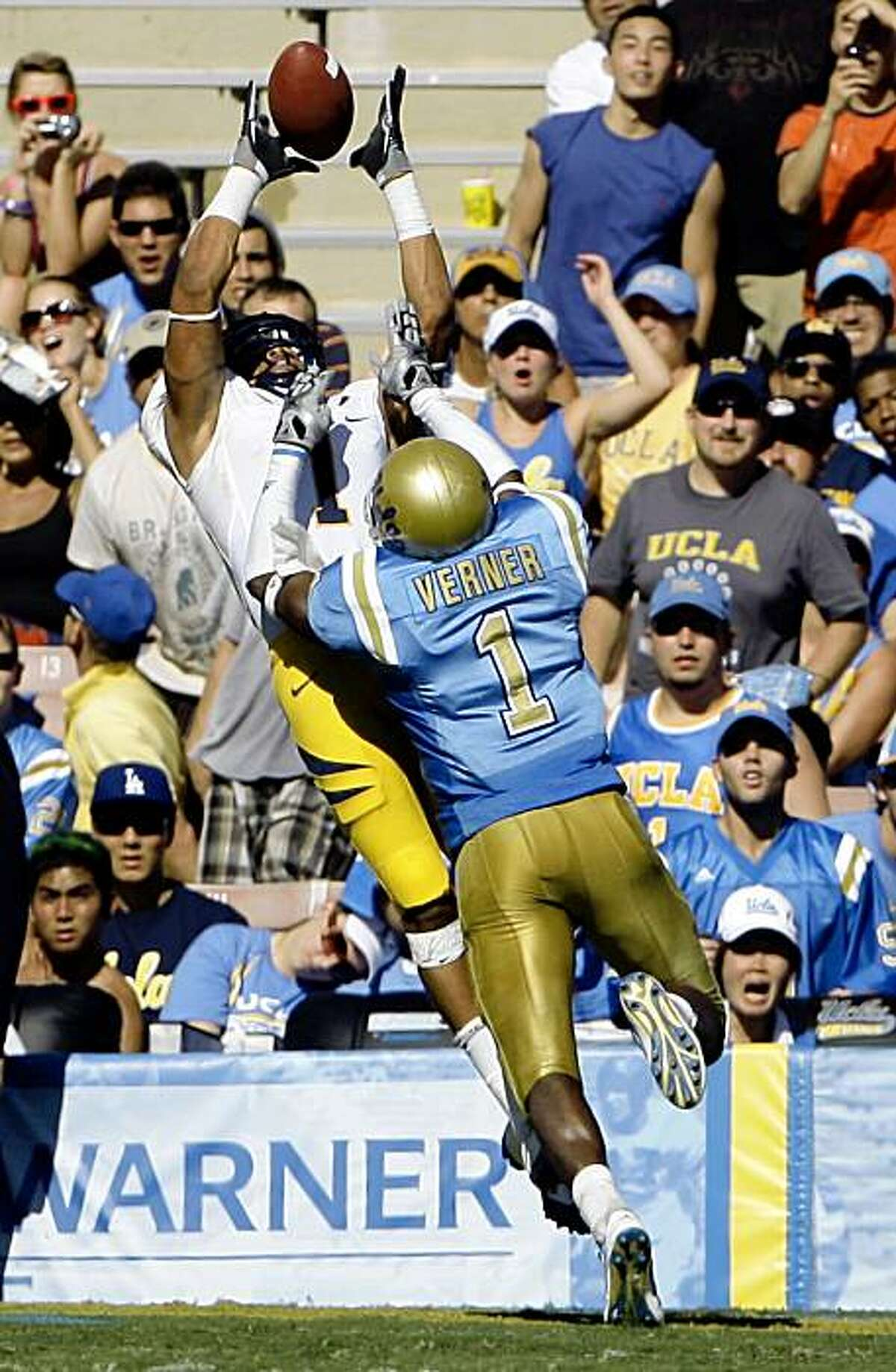 California wide receiver Marvin Jones, left, catches a touchdown pass over the defense of UCLA cornerback Alterran Verner in the second quarter Saturday at the Rose Bowl in Pasadena.