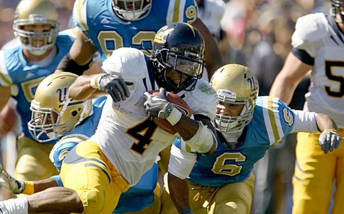 Cal running back Jahvid Best breaks away from the UCLA Bruins defense as he runs for a 93-yard touchdown on Saturday at the Rose Bowl in Pasadena.