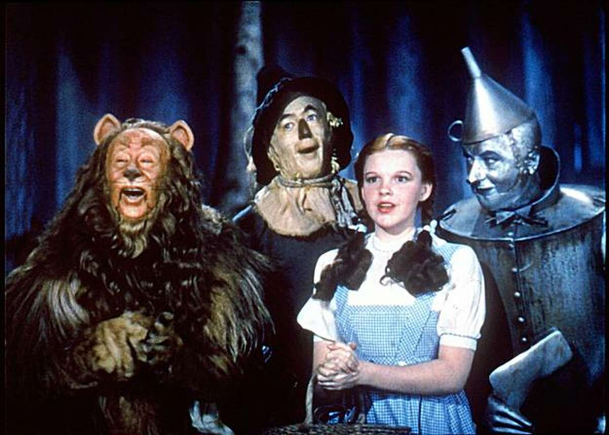 Bert Lahr, Ray Bolger, Judy Garland and Jack Haley in The Wizard of Oz. ALSO Ran on: 10-30-2005 Can run on story for Oct 30, 2009.