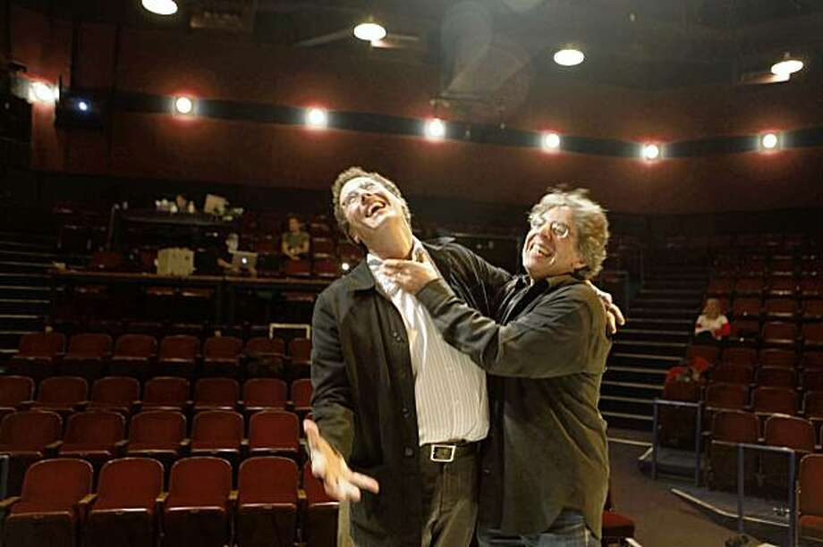 "Playwright Tony Kushner and Berkeley Rep director Tony Taccone goof around before standing for a  portrait at Thrust Stage during the dress rehearsal of ""Tiny Kushner"" on Thursday Oct. 16, 2009 in Berkeley, Calif. Photo: Mike Kepka, The Chronicle"
