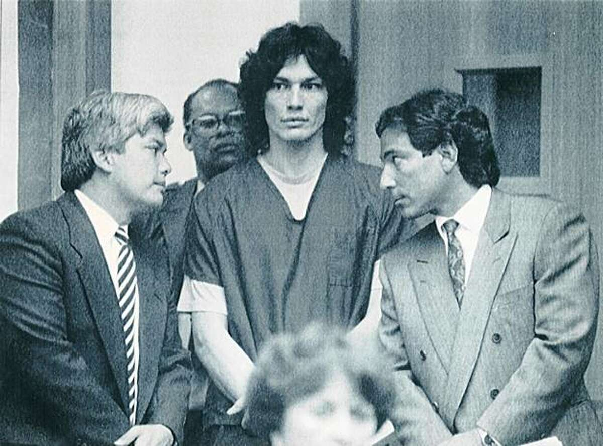 1990 - Richard Ramirez (center) who has been sentenced to death for 13 slayings in Southern California, appears Friday with his attorneys, Randall Martin (right), and Daro Inouye in San Francisco Municipal Court. AP Chronicle File