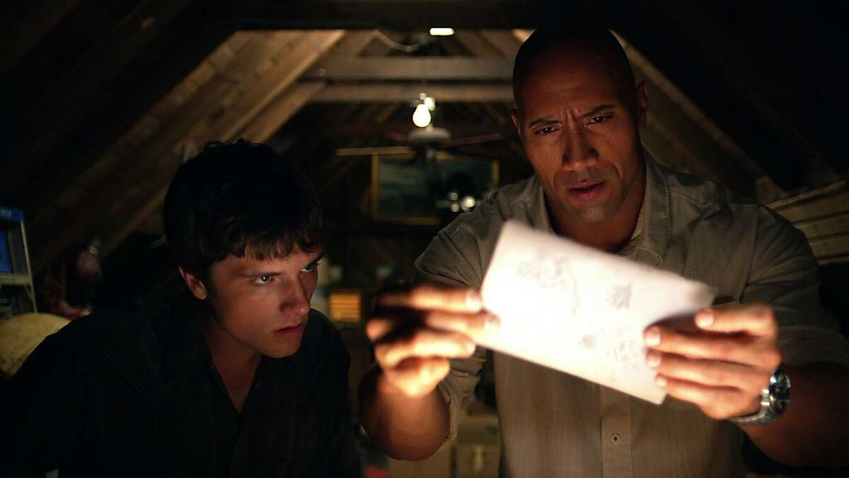 (L-r) JOSH HUTCHERSON as Sean and DWAYNE JOHNSON as Hank in New Line Cinema?•s family adventure ?'JOURNEY 2: THE MYSTERIOUS ISLAND,?