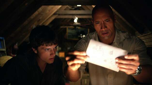 (L-r) JOSH HUTCHERSON as Sean and DWAYNE JOHNSON as Hank in New Line CinemaÕs family adventure ÒJOURNEY 2: THE MYSTERIOUS ISLAND,Ó a Warner Bros. Pictures release. Photo: Courtesy New Line Cinema