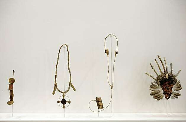 "These pieces are from a work called First Colony, 2009 by Lordy Rodriguez is a mixed media installation.  From Left:  Cellphone, 2009, driftwood and beach grass, 4""x2""; Necklace, 2009, driftwood and beach grass, dimensions variable; MP#, 2009, driftwood, beach grass, twine, dimensions variable; Uokalani Ceremonial Mask, 2009, driftwood and crustacean, dimensions variable.  The Southern Exposure gallery will have the grand opening of their new building at 3030 20th St. in San Francisco, Calif. on Saturday, Oct. 17, 2009. Photo: Russell Yip, The Chronicle"