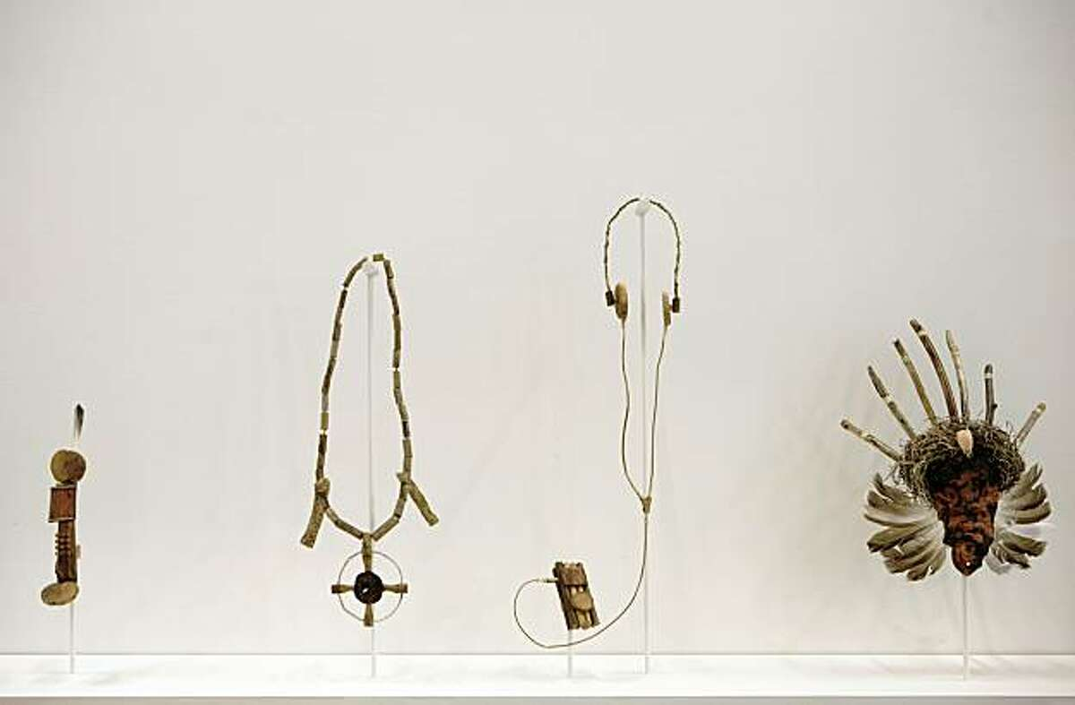 These pieces are from a work called First Colony, 2009 by Lordy Rodriguez is a mixed media installation. From Left: Cellphone, 2009, driftwood and beach grass, 4