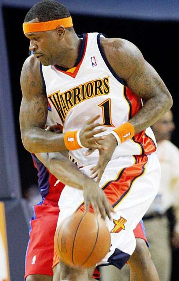 In this photo taken Oct. 4, 2009, Golden State Warriors' Stephen Jackson, front, gets the ball knocked away from him by Los Angeles Clippers' Baron Davis, behind, during a preseason NBA basketball game,  in Oakland, Calif. Jackson, who demanded a trade earlier this year, averaged 20.7 points, 5.1 rebounds and 6.5 assists in 59 games last season. He insists he will continue to play hard as long as he's here. (AP Photo/George Nikitin) Photo: George Nikitin, AP