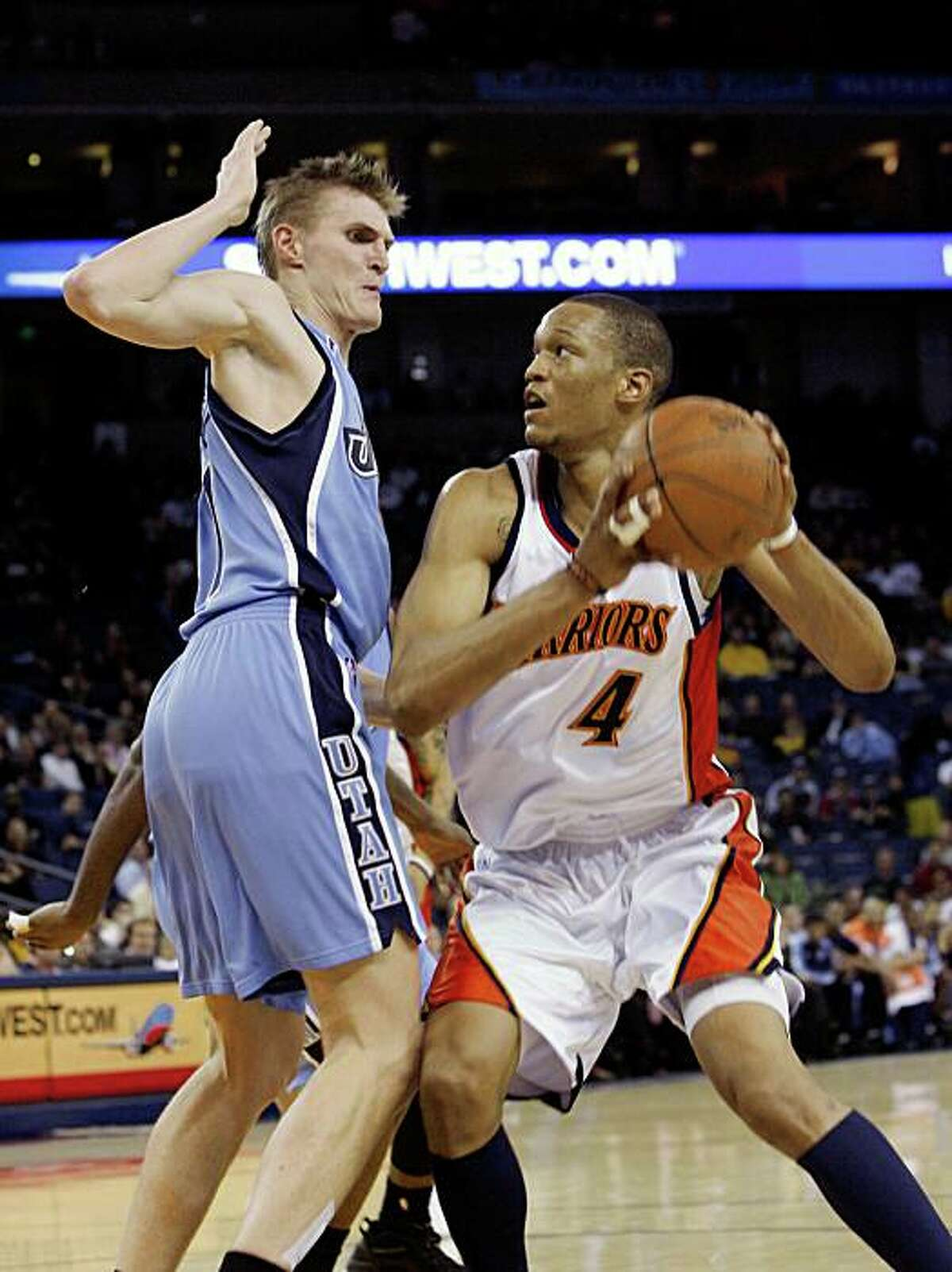 Golden State Warriors guard Anthony Randolph (4), right, goes up for a shot against Utah Jazz forward Andrei Kirilenko (47), left, during a game at Oracle Arena in Oakland, Calif., on Sunday, March 1, 2009. The Jazz beat the Warriors 112-104.
