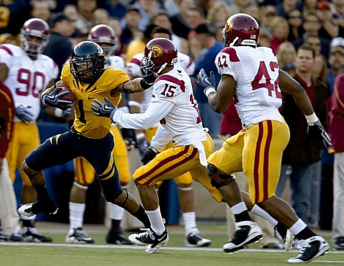 Wide receiver Marvin Jones (1) of the California Golden Bears drive the ball upfield while being defended by cornerback Kevin Thomas (15) of the USC Trojans at Memorial Stadium in Berkeley, Calif. on Saturday, Oct. 3, 2009. The Trojans defeated the Bears 30-3.