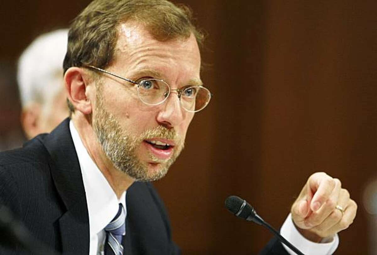 Congressional Budget Office Director Douglas Elmendorf answers questions during a Senate Finance Committee hearing regarding health care reform on Capitol Hill in Washington, Tuesday, Oct. 13, 2009. (AP Photo/Charles Dharapak)