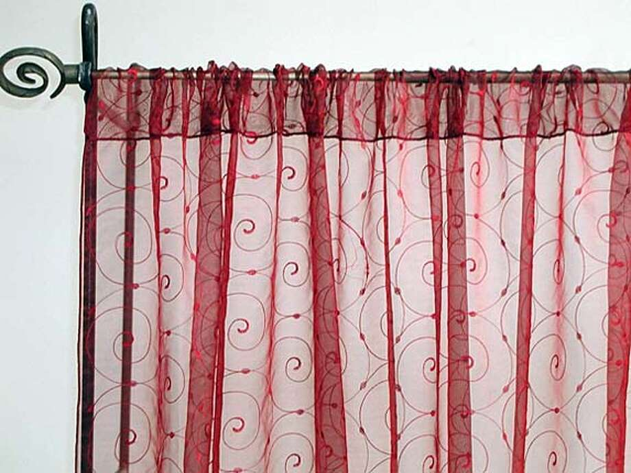 Sheer Red.JPG Sally Socolich column to be printed for bargain hunter section on march 17th. Our company name is Shamiana and if you need detailed info for the pictures sent, sheer red Photo: Handout