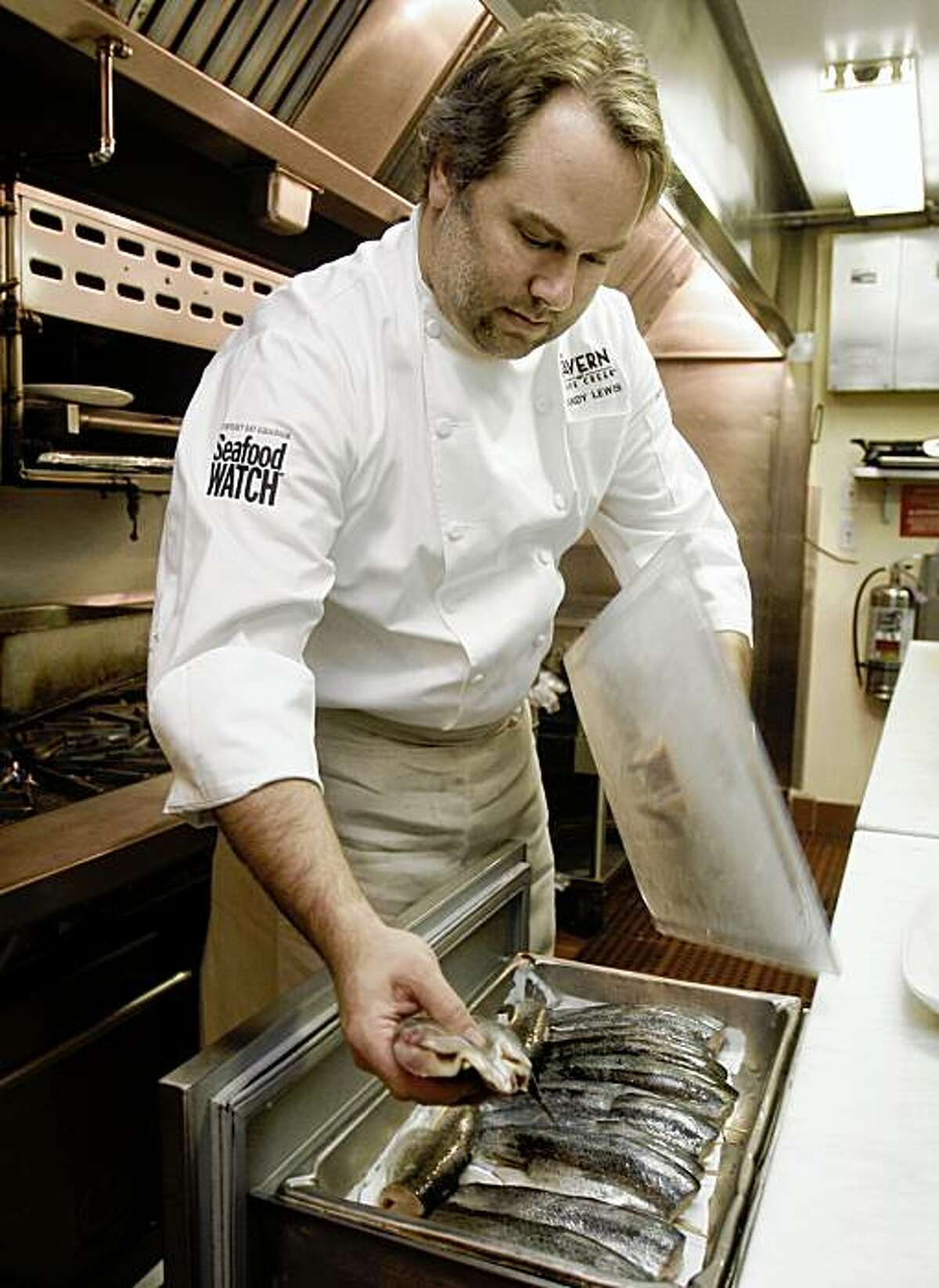 Chef Randy Lewis preparing trout at Tavern at Lark Creek in Larkspur, Calif., on Monday, October 19, 2009.