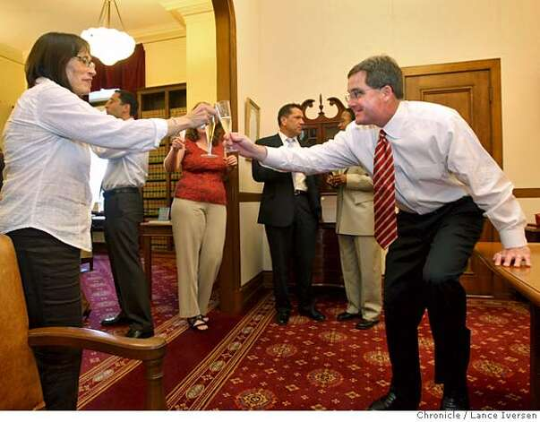 San Francisco City Attorney Dennis Herrera hosted a small reception in his office Wednesday May 15, 2008 clinking glasses with Monica Quattrin a legal Secritary that typed the legal brief that was presented to the California Supreme Court. In a 4-3 decision, the justices voted giving Gays and lesbians constitutional right to marry. Photographed in San Francisco, Calif, By Lance Iversen / San Francisco Chronicle. Photo: LANCE IVERSEN