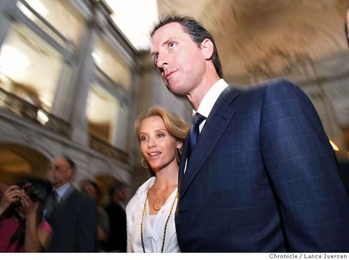 San Francisco Mayor Gavin Newsom walks out a press conferance in the City Hall rotunda after the California Supreme Court desistion giving Gays and lesbians constitutional right to marry in California with his fiancee Jennifer Siebel. Photographed in San Francisco, Calif, By Lance Iversen / San Francisco Chronicle.