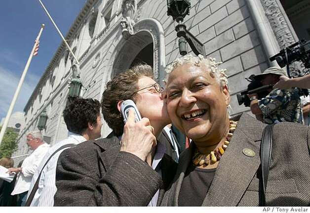 Diane Sabin, left, kisses her partner of 16 years Jewelle Gomez, right after hearing the Supreme Court decision on same sex marriages outside the court house in San Francisco, Calif., on Thursday, May 15, 2008. In a monumental victory for the gay rights movement, the California Supreme Court overturned a voter-approved ban on gay marriage Thursday in a ruling that would allow same-sex couples in the nation's biggest state to tie the knot. (AP Photo/ Tony Avelar) Photo: Tony Avelar
