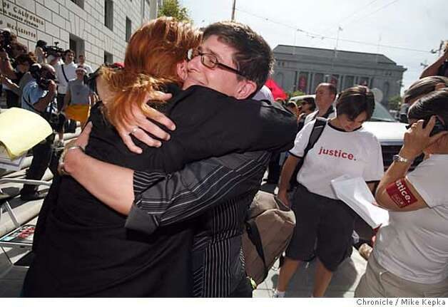 Supporters of same-sex marriage, Maya Scott-Chung and Beth Teper, of Oakland, Calif. hug on the step the California Supreme court after a ruling announcing that it is unconstitutional to disallow same-sex marriages in the state of California on Thursday May 15, 2008 in San Francisco, Calif. Teper is the daughter of a Lesbian mother and has been waiting for this day for her entire life.  Photo by Mike Kepka/San Francisco Chronicle Photo: Mike Kepka