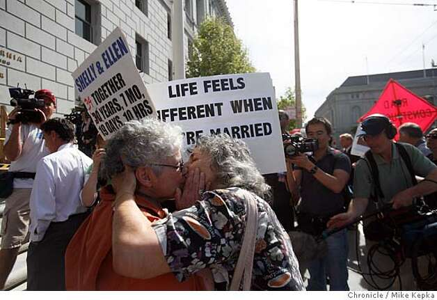 Supporters of same-sex marriage, Shelly Bailes and Ellen Pontac, of Davis, Calif, kiss on the step the California Supreme court after a ruling announcing that it is unconstitutional to disallow same-sex marriages in the state of California on Thursday May 15, 2008 in San Francisco, Calif. Bailes and Pontac have been together for 34 years and say they can't believe this finally has come. Photo by Mike Kepka/San Francisco Chronicle Photo: Mike Kepka