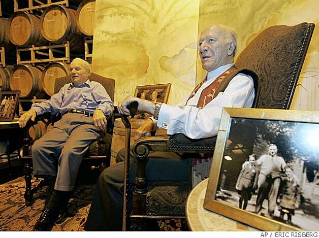 **FILE** In this June 3, 2005 file photo, Peter Mondavi, left, and his brother Robert Mondavi, right, sit together during the festival event of the Napa Valley wine auction in St. Helena, Calif. A winery spokeswoman says California winemaking patriarch Robert Mondavi died Friday, May 16, 2008, at his home in Yountville, Calif. He was 94 .(AP Photo/Eric Risberg) Photo: ERIC RISBERG, AP