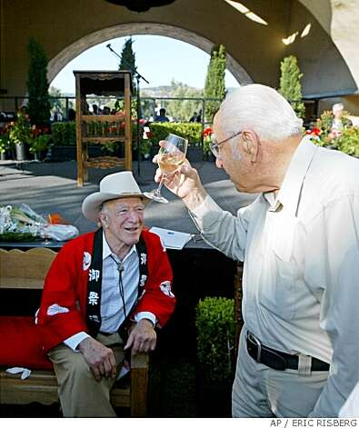 ** FILE ** In this file photo, Winemaker Ernest Gallo, right, toasts winemaker Robert Mondavi at Mondavi's 90th birthday celebration in Oakville, Calif., Wednesday, June 18, 2003. Gallo, the marketing genius who parlayed $5,900 and a wine recipe from the Modesto Public Library into the world's largest winemaking empire, died Tuesday, March 6, 2007, at his home in Modesto, Calif., He was 97. (AP Photo/Eric Risberg)Ran on: 03-09-2007Ernest Gallo 1909-2007Ran on: 03-09-2007Ernest Gallo 1909-2007 ** FILE ** In this file photo, Winemaker Ernest Gallo, right, toasts winemaker Robert Mondavi at Mondavi's 90th birthday celebration in Oakville, Calif., Wednesday, June 18, 2003. Gallo, the marketing genius who parlayed $5,900 and a wine recipe from the Modesto Public Library into the world's largest winemaking empire, died Tuesday, March 6, 2007, at his home in Modesto, Calif., He was 97. (AP Photo/Eric Risberg) Ran on: 03-09-2007 Ernest Gallo 1909-2007 Ran on: 03-09-2007 Ernest Gallo 1909-2007 Photo: ERIC RISBERG, AP