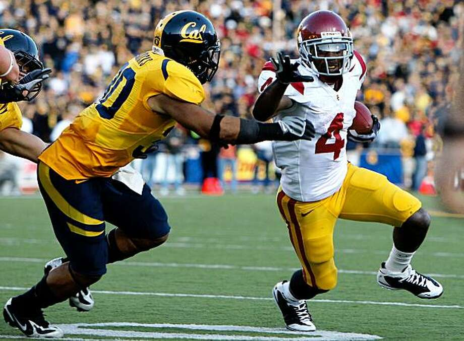 BERKELEY, CA - OCTOBER 03:  Joe McKnight #4 of the USC Trojans runs against Mychal Kendricks #30 of the California Golden Bears at Memorial Stadium on October 3, 2009 in Berkeley, California.  (Photo by Jed Jacobsohn/Getty Images) Photo: Jed Jacobsohn, Getty Images