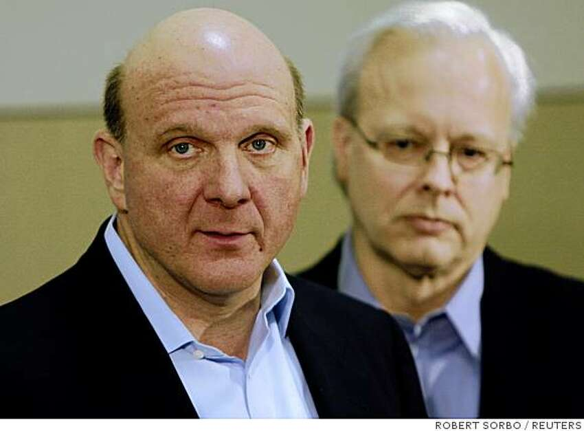 Microsoft CEO Steve Ballmer (L) with Ray Ozzie, chief software architect at his side, speaks to reporters at a news conference at the company headquarters in Redmond, Washington, February 21, 2008. Ballmer announced that Microsoft was changing its technology and business practices to increase openness of its products and bring greater interoperability and choice for developers, partners, customers and competitors. REUTERS/Robert Sorbo (UNITED STATES)