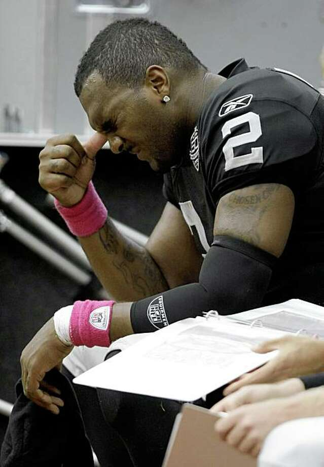 Oakland Raiders quarterback JaMarcus Russell sits on the bench between series during the 3rd quarter of an NFL football game at Reliant Stadium Sunday, Oct. 4, 2009, in Houston. The Texans beat the Raiders 29-6. Photo: Brett Coomer, Hearst Newspapers
