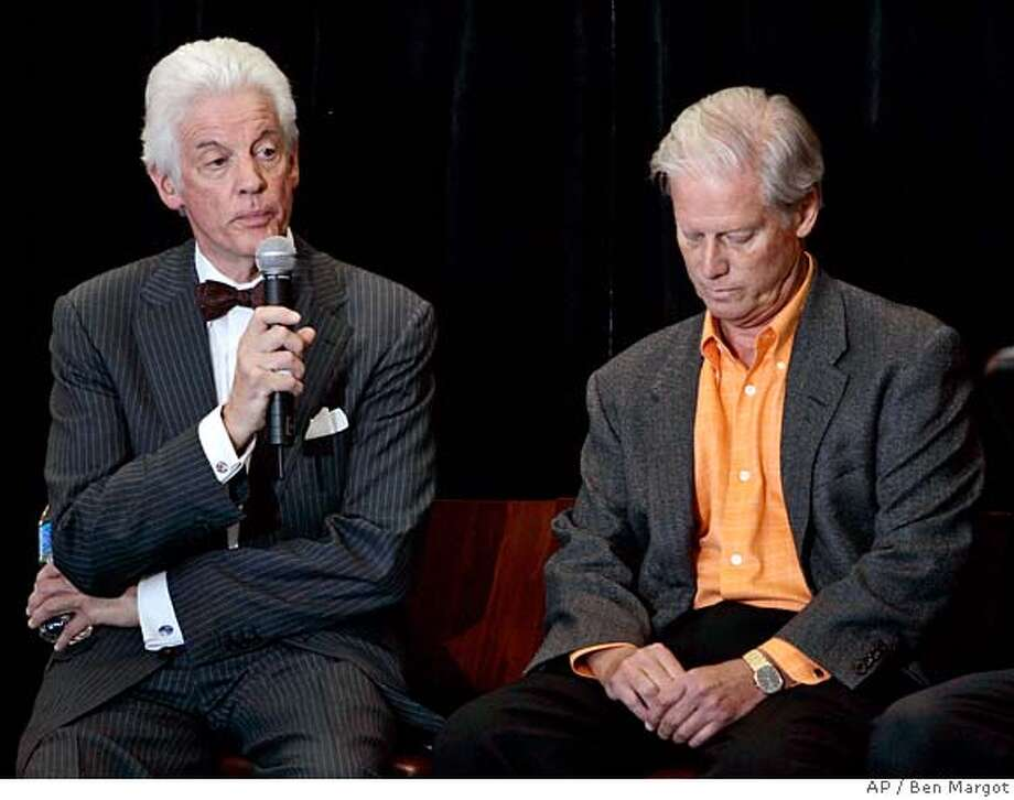 San Francisco Giants owner and managing general partner Peter Magowan, right, lowers his head as William Neukom, currently a general partner in the ownership group, speaks during a media conference Friday, May 16, 2008, in San Francisco. Magowan, the owner who brought Barry Bonds to San Francisco, built a new ballpark and kept major league baseball in the city, is stepping down as managing partner of the Giants at the end of this season, to be replaced by Neukom. (AP Photo/Ben Margot) Photo: Ben Margot