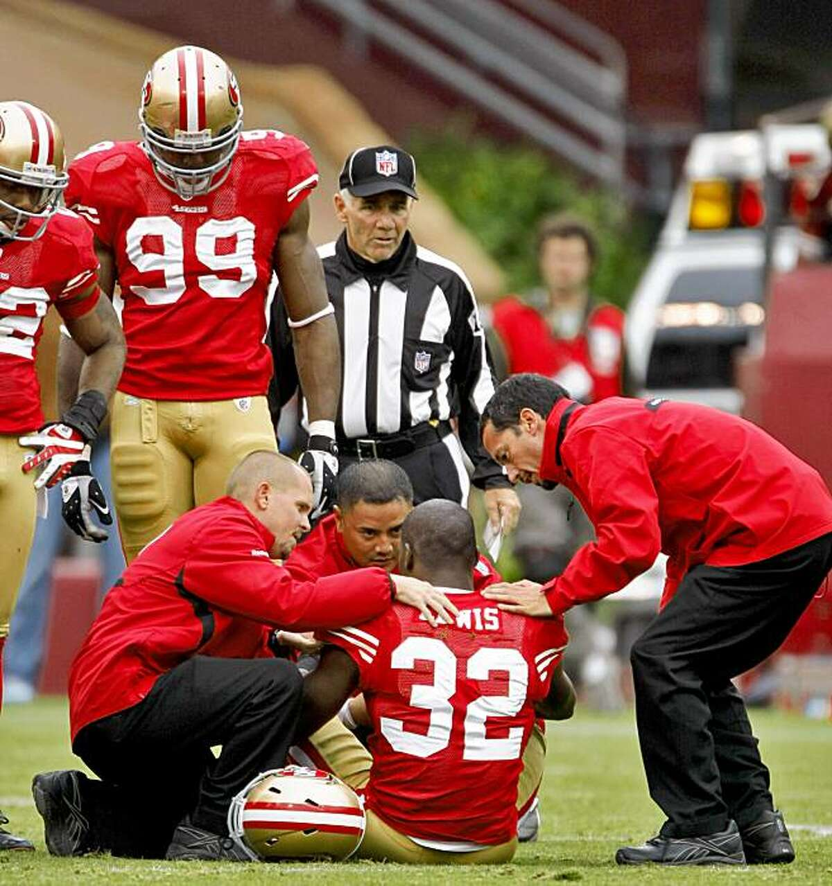 Michael Lewis is injured in the first half of the 49ers' game against the Atlanta Falcons on Sunday at Candlestick in San Francisco.