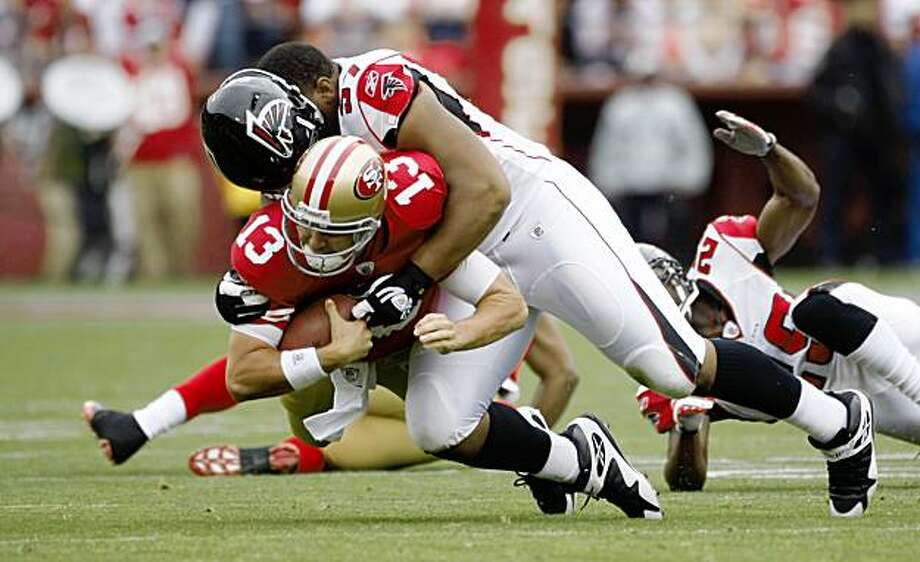 49ers quarterback Shawn Hill is brought down after making a first down, in the first half Sunday at Candlestick in San Francisco. Photo: Lacy Atkins, The Chronicle