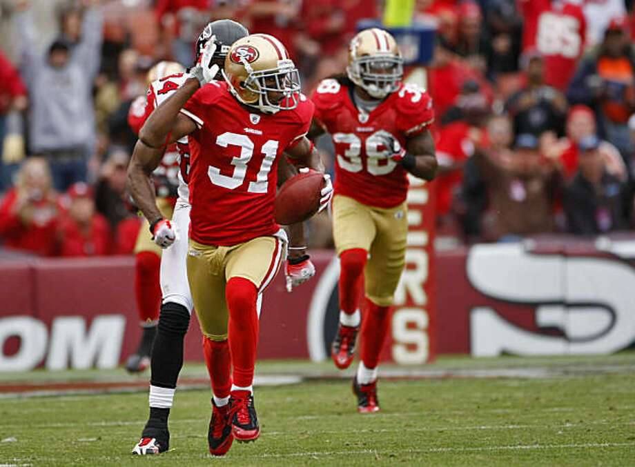 San Francisco 49ers' Dre Bly intercepts a pass in the third quarter and then fumbles against the Atlanta Falcons on Sunday at Candlestick in San Francisco. Photo: Lacy Atkins, The Chronicle