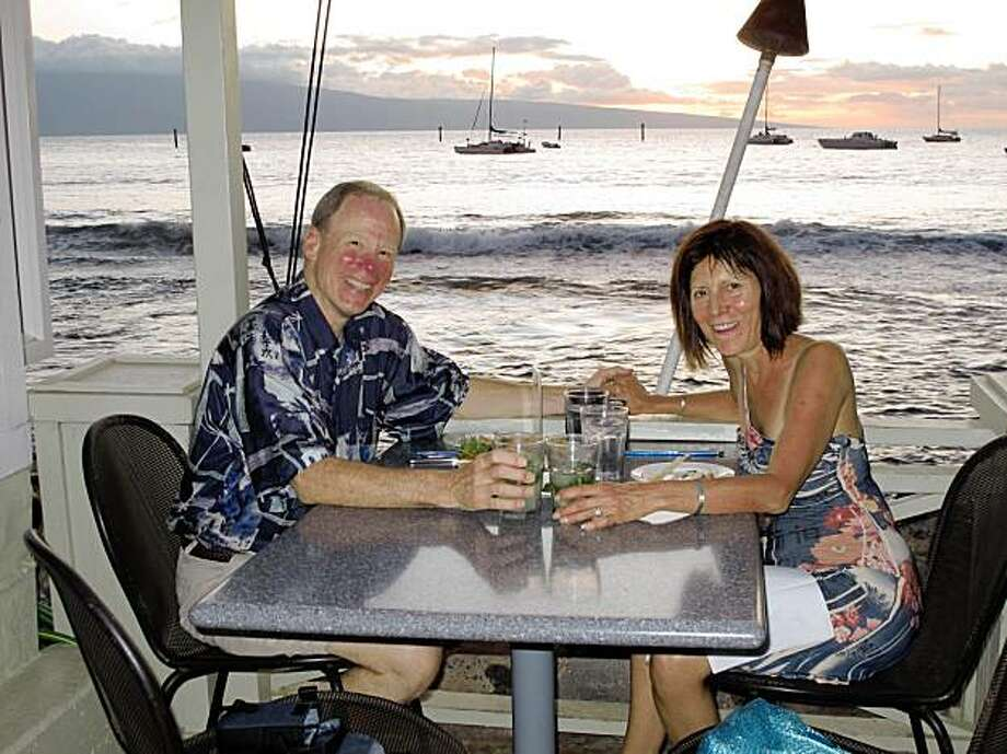Will and Elisa Southard with their dining companion, the Maui Sunset at Mala harbor. Photo: Courtesy Of Will And Elisa Southard