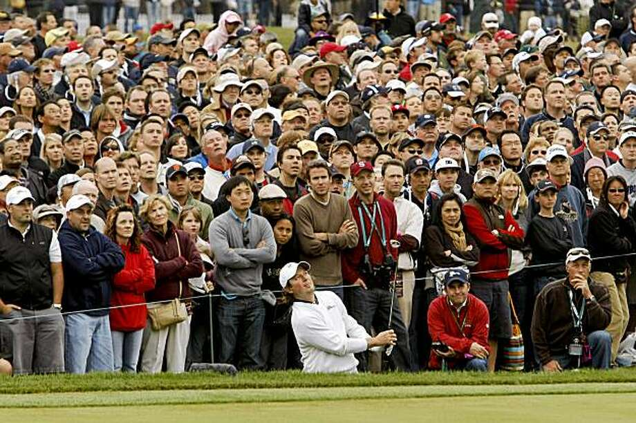 Tim Clark hits his third shot well past the cup on the 18th hole as Tiger Woods and Steve Stricker went on to defeat Mike Weir and Tim Clark 1 up during the morning round of foursome matches of the  2009 President's Cup Golf Tournament on Saturday October 10, 2009 at Harding Park Golf Course in San Francisco, Calif. Photo: Michael Macor, The Chronicle