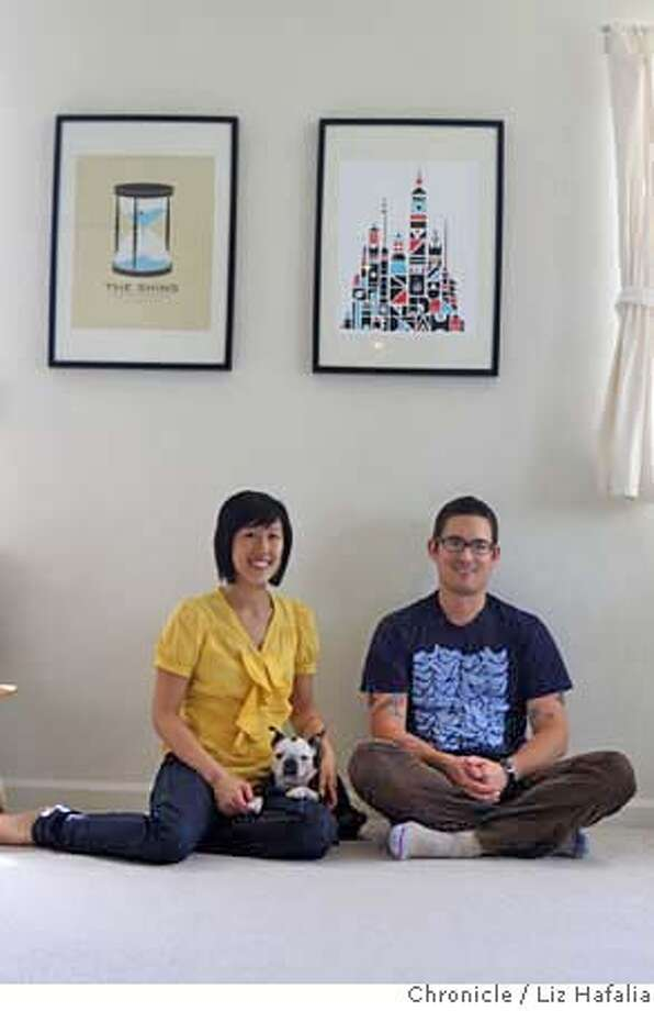 """###Live Caption:Graphic designer Lisa Wong Jackson, her  husband, Nick Jackson, and Boston Terrier, Pixel, live in a 790-square-foot condo in Berkeley, Calif., filled with prints and posters, many of them limited edition prints on Friday, May 9, 2008. Above them is """"The Shins"""" music poster by Jason Munn at left, and a tri color piece by Cody Hudson at right. Photo by Liz Hafalia / San Francisco Chronicle###Caption History:Graphic designer Lisa Wong Jackson, her  husband, Nick Jackson, and Boston Terrier, Pixel, live in a 790-square-foot condo in Berkeley, Calif., filled with prints and posters, many of them limited edition prints on Friday, May 9, 2008. Above them is """"The Shins"""" music poster by Jason Munn at left, and a tri color piece by Cody Hudson at right. Photo by Liz Hafalia / San Francisco Chronicle###Notes:Graphic designer Lisa Wong Jackson, her  husband, Nick Jackson, and Boston Terrier, Pixel, live in a 790-square-foot condo in Berkeley, Calif., filled with prints and posters, many of them limited edition prints on Friday, May 9, 2008. Above them is """"Th###Special Instructions:�2008, San Francisco Chronicle/ Liz Hafalia  MANDATORY CREDIT FOR PHOTOG AND SAN FRANCISCO CHRONICLE. NO SALES- MAGS OUT. Photo: Liz Hafalia"""