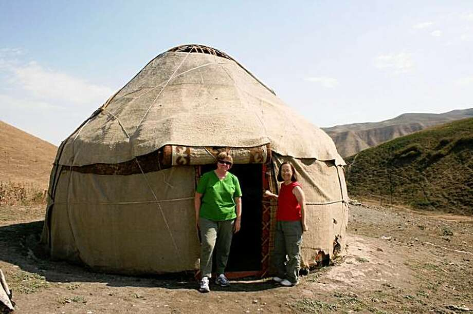 Chelan McCandless (left) and Pamela Luiz (right) in front of a yurt in Bishkek, Krygyzstan. Photo: N/a