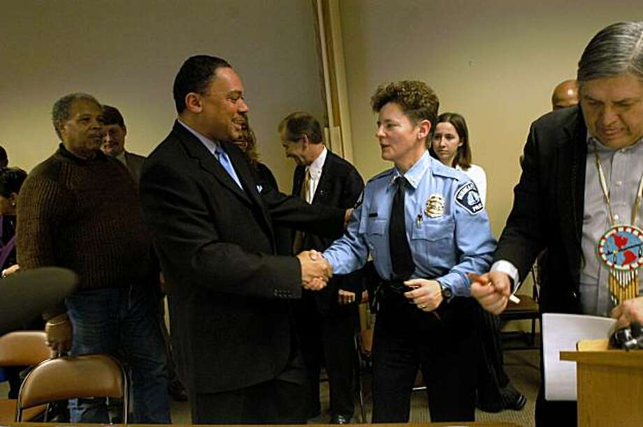 Co. Chair of the Unity Community Mediations Team Rev. Ian Bethel shakes hands with Minneapolis police officer Sharon Lubinski after signing  federal mediation agreements at the Minneapolis Urban League on December 4, 2003 in Minneapolis. Lubinski could become the first openly gay U.S. marshal after President Barack Obama nominated the 57-year-old assistant police chief to one of the country's top law enforcement jobs last week. Photo: Kyndell Harkness, Minnesota Star-Tribune
