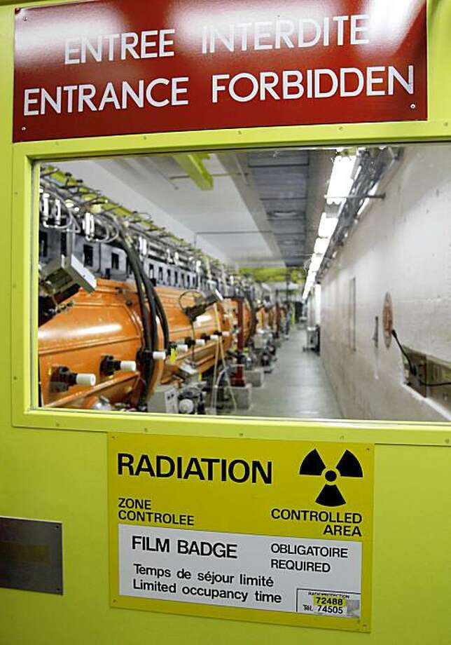 FILE - In this Oct. 16, 2008 file picture the inside view of a facility in the CERN laboratories is pictured near Geneva, Switzerland.  French police have arrested a nuclear physicist on suspicion that he had links to terrorist organizations in Algeria, the European Organization for Nuclear Research said Friday Oct. 9, 2009.  The man was one of more than 7,000 scientists working at the organization and has been assigned to analysis projects under contract with an outside institute, said the organization, known as CERN. (AP Photo/Keystone, Martial Trezzini,File).  (AP Photo/Keystone/Keystone,Martial Trezzini,File) Photo: Martial Trezzini, File, AP