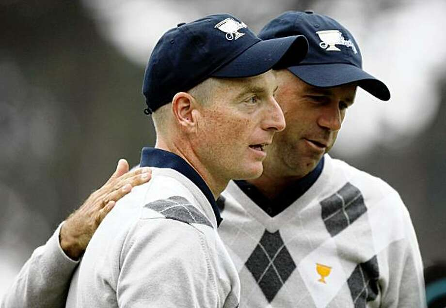 United States Jim Furyk is greeted on the 18th green by teamamte Stewart Cink after Furyk and Anthony Kim defeated Angel Cabrera and Adam Scott from the International team in the afternoon Four-Ball rounds of the Third day at the 2009 Presidents Cup at Harding Park in San Francisco California Saturday Oct 10, 2009 Photo: Lance Iversen, The Chronicle