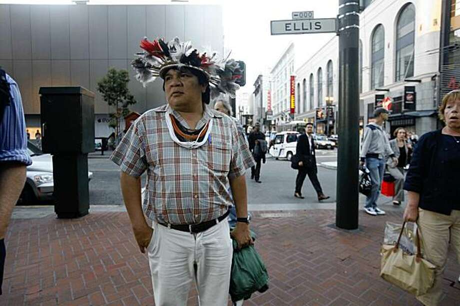 Wearing an Amazonian headdress, Chief Almir Surui, leader of an endangered Amazon tribe investigates the bustling blocks near Market and Powell on Thursday Oct. 16, 2009 in San Francisco, Calif. Almir Surui is in town with a group called the Amazon Conservation Team for an environmental conference to unveil he early fruits of an unusual partnership with Google Inc.. pairing cutting edge technology and indigenous knowledge in an effort to rescue ancient rainforests and a dying culture. Photo: Mike Kepka, The Chronicle