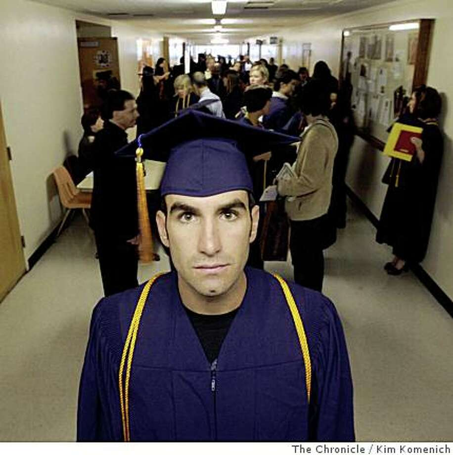 Aaron Augustis prepares for the honors ceremonies at San Francisco State University on Thursday, May 22, 2008. Augustis is among a growing number of former soldiers who, upon returning from duty in Iraq, are reinventing themselves for the civilian world.Photo by Kim Komenich / San Francisco Chronicle Photo: Kim Komenich, The Chronicle