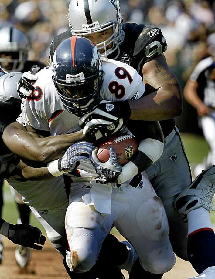 Richard Seymour wrapped up tight end Daniel Graham in the second half. Oakland Raiders in action against the Denver Broncos Sunday September 27, 2009. The Raiders lost 23-3. Photo: Brant Ward, The Chronicle